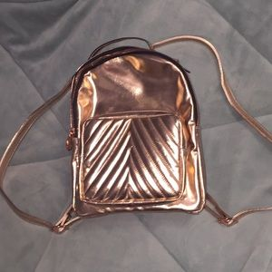 Madden girl rose gold mini backpack